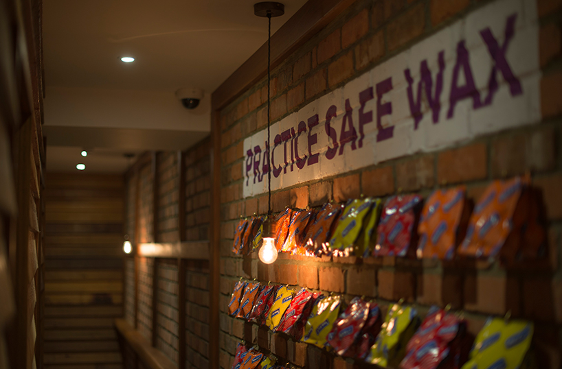 Ministry of Waxing condom wall